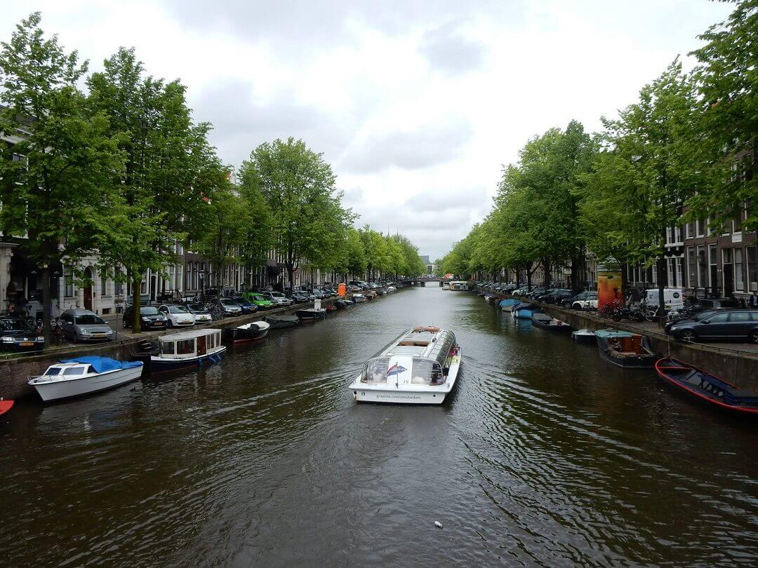 Amsterdam by train - A typical Dutch canal